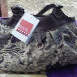 Relic handbag still with tags